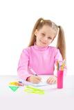 Mała uczennica przy stołowym writing Obrazy Stock