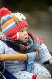 Mała zimy chłopiec w spacerowiczu Fotografia Royalty Free