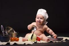 Małe dziecko szef kuchni zdjęcie royalty free