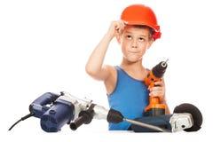 Małe dziecko z elektrycznym śrubokrętem Obrazy Royalty Free