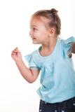 Małej dziewczynki kłapnięcie ona palce obraz stock