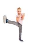 Małej dziewczynki kopnięcie stopą. Zdjęcie Stock