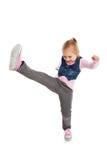 Małej dziewczynki kopnięcie stopą. Obrazy Royalty Free