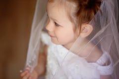 Małej dziewczyny odzieży biała przesłona obrazy royalty free
