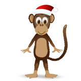 Małpuje z Santa kapeluszem odizolowywającym na białym tle Obraz Royalty Free