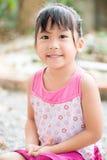 Mały śliczny azjatykci uśmiech Obraz Royalty Free