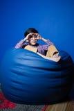 Mały Azjatycki chłopiec obsiadanie Zdjęcia Stock