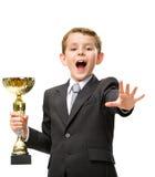 Mały biznesmen wręcza złotą filiżankę Zdjęcie Royalty Free