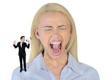 Mały biznesowy mężczyzna krzyczy na kobiecie Zdjęcia Royalty Free