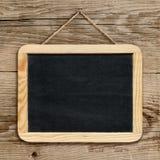 Mały blackboard obwieszenie na ścianie fotografia royalty free