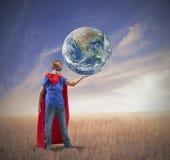 Mały bohatera save świat Zdjęcia Royalty Free
