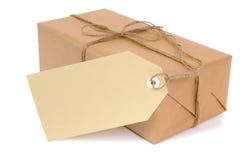 Mały brown papieru pakunek z etykietką obrazy royalty free