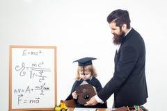Mały chłopiec dziecko, nauczyciel i obrazy royalty free