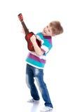 mały chłopiec gitary grać zdjęcie royalty free