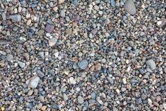 Mały kamieni otoczaków piaska tło Zdjęcie Stock