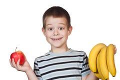 mały owocowy chłopiec mienie Zdjęcia Stock