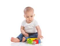 Mały piękny dziecko bawić się z tambourine Zdjęcia Royalty Free