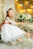 Mały princess obsiadanie blisko stołu zdjęcie royalty free