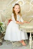 Mały princess obsiadanie blisko stołu zdjęcia royalty free