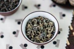 Mały puchar susi zielona herbata liście Fotografia Royalty Free