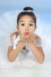 Mały tancerz, balerina w biel sukni nad błękit Zdjęcie Stock