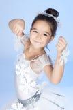 Mały tancerz, balerina w biel sukni nad błękit Zdjęcia Stock