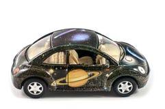 Mały zabawkarski samochód Malować planety i gwiazdy Zdjęcia Royalty Free