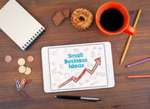 Małych Biznesów pomysłów pojęcie Pastylka na starym drewnianym stole Obrazy Stock