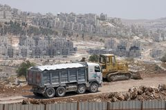 Israeli colonists building settlement bloc Maale Adumim or Ma`ale Adumimin. royalty free stock photos