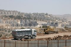 Israeli colonists building settlement bloc Maale Adumim or Ma`ale Adumimin. royalty free stock photography