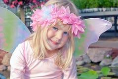 Mała czarodziejska dziewczyna w ogródzie Obrazy Royalty Free