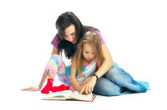 Ma and daughter read book royalty free stock photo