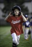 Mała dziewczynka biega bazy Obraz Royalty Free