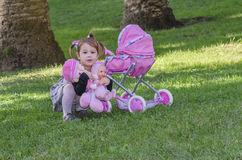 Mała dziewczynka i lale Zdjęcie Stock