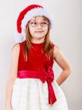 Mała dziewczynka patrzeje jak Santa elf Obrazy Stock