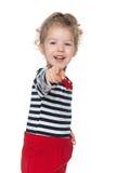 Mała dziewczynka pokazuje jej palec naprzód Obraz Stock
