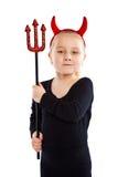Mała dziewczynka w czarcim kostiumu. Zdjęcia Royalty Free