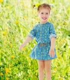 Mała dziewczynka w krótkiej sukni Zdjęcia Royalty Free