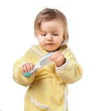 Mała dziewczynka w opatrunkowej todze zdjęcia royalty free