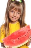 Mała dziewczynka z arbuzem Obrazy Stock