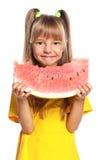 Mała dziewczynka z arbuzem Zdjęcia Stock