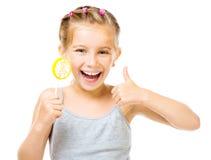 Mała dziewczynka z lizakiem Zdjęcie Royalty Free