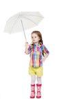 Mała dziewczynka z parasolem w gumie i Obrazy Stock