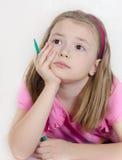 Mała dziewczynka z porady piórem Zdjęcia Royalty Free