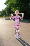 Mała dziewczynka z rolownikami Obraz Royalty Free