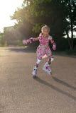 Mała dziewczynka z rolownikami Zdjęcie Stock
