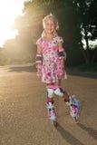 Mała dziewczynka z rolownikami Zdjęcia Stock