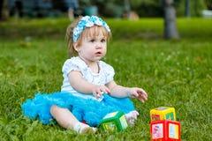 Mała dziewczynka z zabawkami Zdjęcia Stock