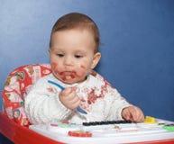 Mała dziewczynka zabazgrana z jedzeniem Obraz Royalty Free