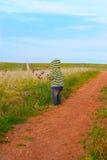 Małe dziecko w pasiastej kurtce z kapiszonem Fotografia Royalty Free